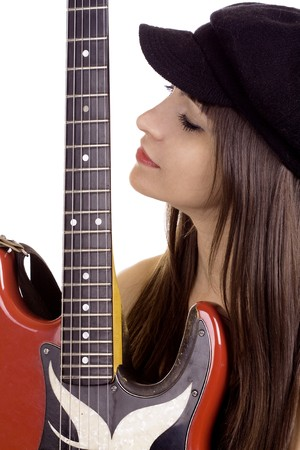 Young woman with beret hat holding red electric guitar photo
