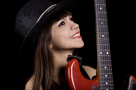 Female country singer holding a red guitar photo