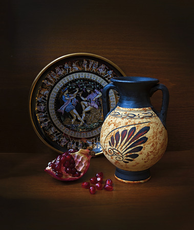 Antique Greek vase plate and pomegranate