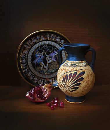 antique vase: Antique Greek vase plate and pomegranate