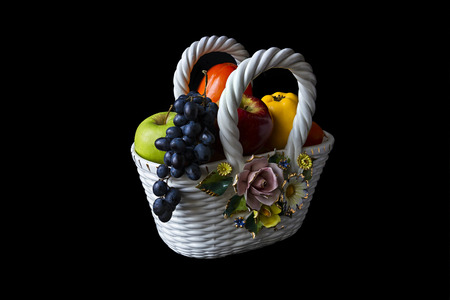 Italian ceramic vase with fruit on a black background