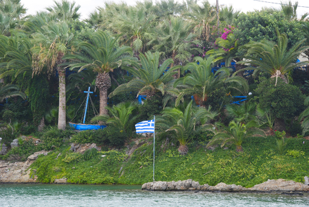 View on the grassy palm bay of Sisi on the isle Crete in Greece from the port of Sisi Stock Photo