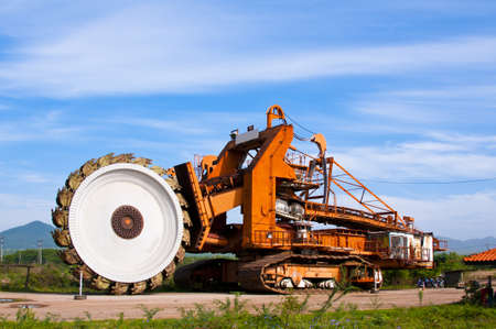 Gigantic bucket wheel excavator under blue sky  Stock Photo - 20352242