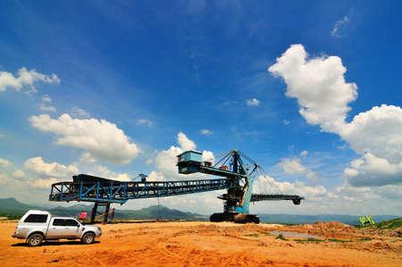 open pit: Gigantic conveyor belt machine in open pit mine Stock Photo