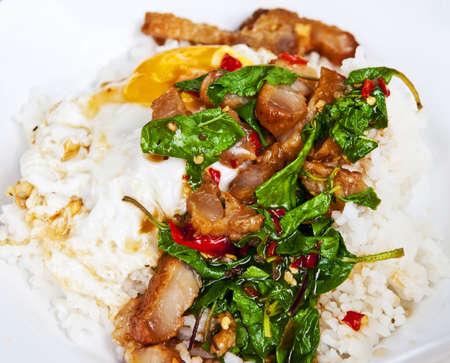 thai basil: Fried bbq pork, basil and egg over rice   very popular Thai spicy dish