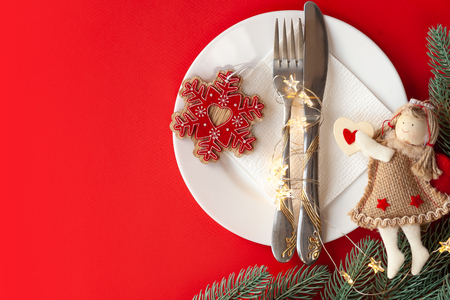 Served christmas table scratched with decorative symbols on a red background