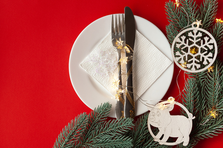 Served Christmas table scratched with decorative New Year symbols on a red background