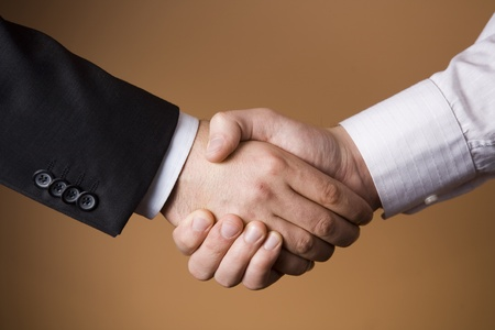 Two Businessmen shaking hands - Deal - Finance - Business - Agreement