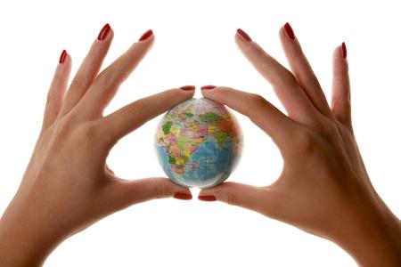 Womans hands holding small world - Globe - Planet - Business Фото со стока