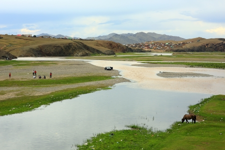 Horses grazing near river at Ulaanbaatar Suburbs, mongolia photo
