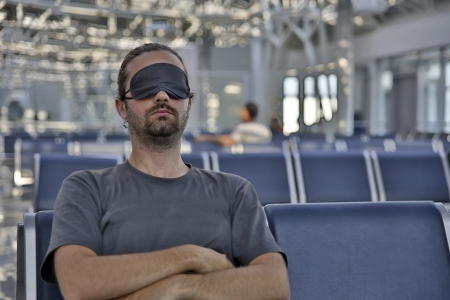eye traveller: sleeping in airport with eye cover
