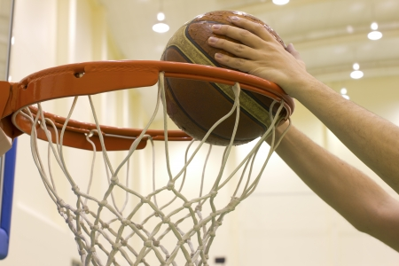 scoring basket in basketball court photo