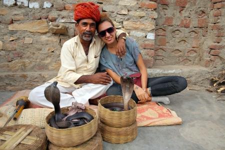 indian village: Indian Cobra enchanter and tourist girl