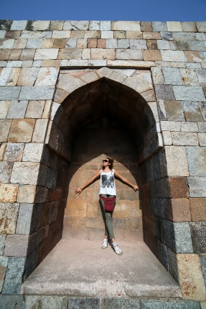 Caucasian tourist girl at Qutb Minar, New Delhi photo