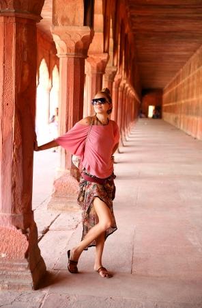 Caucasian woman at courtyard of Taj Mahal