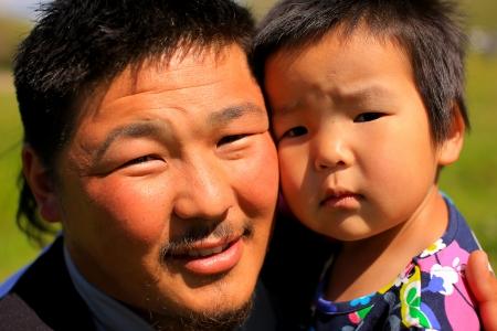 Mongolian man posing with his daughter
