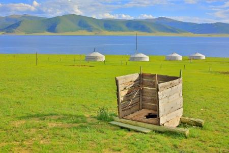 Mongolian wooden squat toilet outside yurt, grassland of mongolia Stockfoto