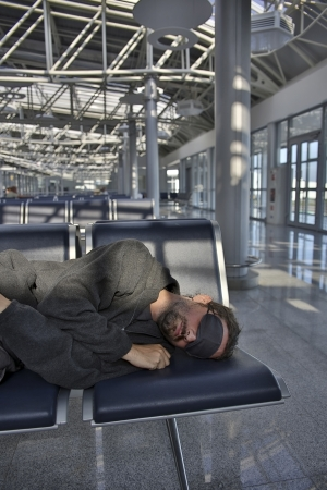 sleeping in airport with eye cover photo