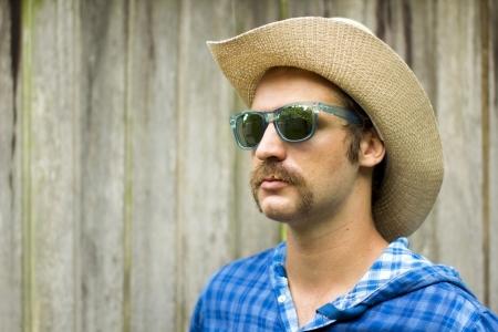 cowboy on wooden background Фото со стока