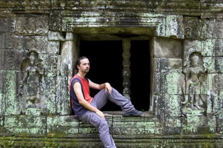 caucasian tourist travel in preah khan temple, angkor, cambodia