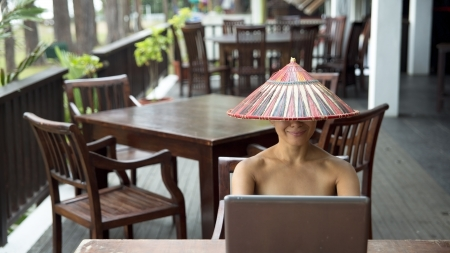 Freelance asian business woman working at cafe