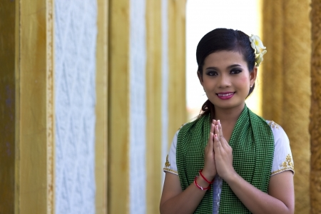 khmer: Asian Girl Greets in temple traditional way with both hands Stock Photo
