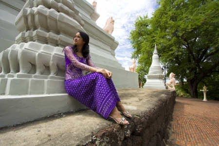 laos: Asian Girl with Traditional Clothes in Temple