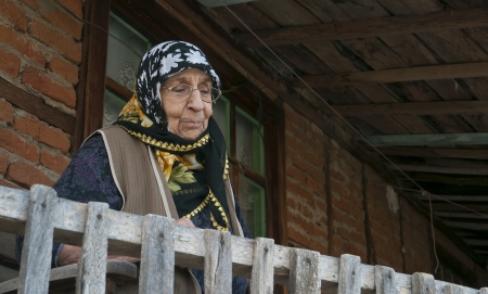 Senior woman watching from balcony - Grandmother - Old - House