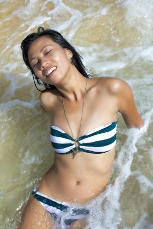 hot legs: Sexy Asian Girl at Exotic Beach Enjoys with Sun Sea