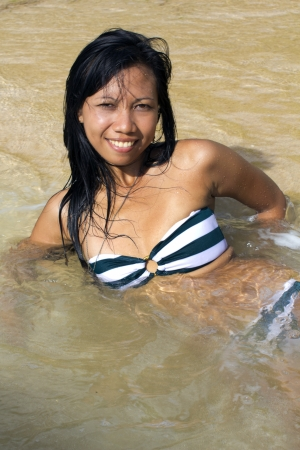 sexy asian girl: Sexy Asian Girl at Exotic Beach Enjoys with Sun Sea