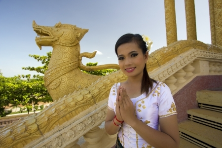 salutation: Asian Girl Greets in temple traditional way with both hands Stock Photo