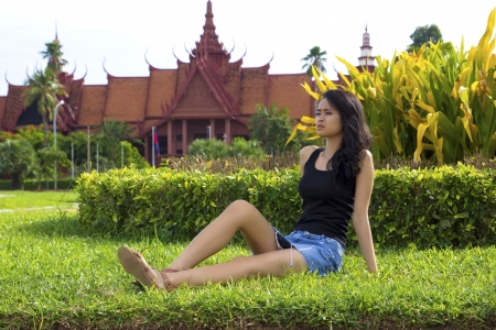 grass skirt: Asian attractive girl on grass, national museum, phnom penh, cambodia Stock Photo