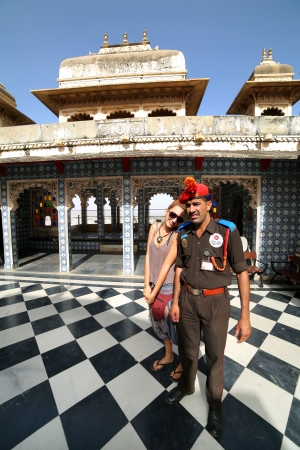 civilisation: UDAIPUR, RAJASTHAN, INDIA - APRIL, 2013: Female tourist and security at City Palace