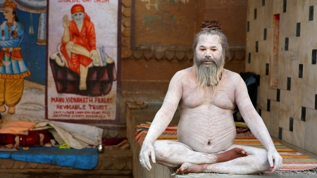 VARANASI, INDIA - MAY 2013: Naked Sadhu posing