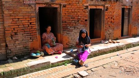 kathmandu: KATHMANDU, NEPAL - JUNE 2013: local women knitting at street Editorial