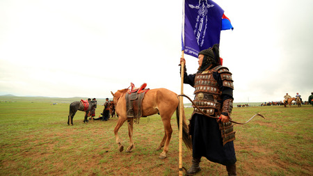 mongolia horse: ULAANBAATAR, MONGOLIA - JULY 2013: Naadam Festival Horse Archery Crew with horse and traditional medieval outfit, posing Editorial