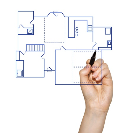 home renovations: hand drafting a blueprint for a house