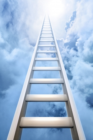ladder of success reaching into a blue sky and clouds