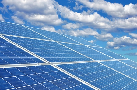 Blue solar panels creating eco-friendly green energy from the sun