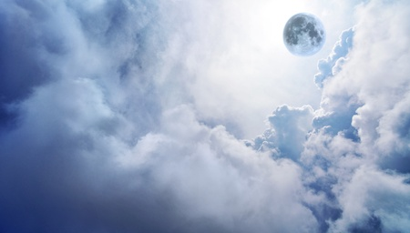 spiritual light: Wispy clouds and a fantasy moon Stock Photo