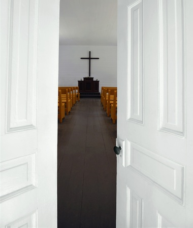 Church doors opening to the sanctuary Stock fotó