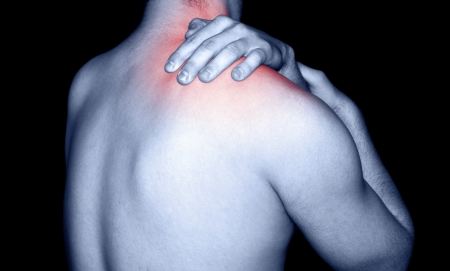 aching muscles: Man massaging a shoulder pain
