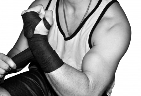 Mixed martial arts fighter wrapping his wrists photo