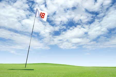 18: Golf flag at hole 18 on the putting green