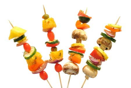 Fun way to eat healthy vegetables; kebabs with tomatoes, mushrooms, onions, zucchini, peppers Stock Photo