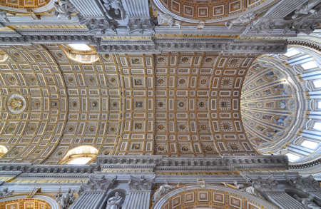 Interior architectural detail of the vaulted ceiling in Saint Peters Basilica, Vatican City