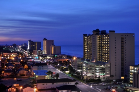 rentals: City lights from vacation rentals and other businesses along the coast at night Stock Photo