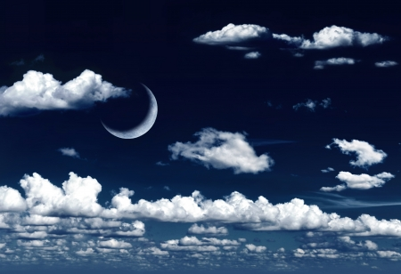 Crescent moon in dreamy night sky and clouds