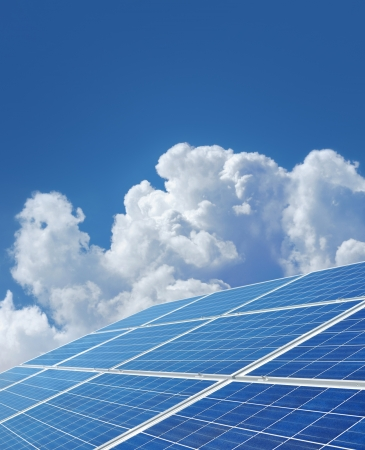 Blue solar power panels generating renewable energy Stock Photo