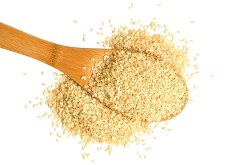 Big scoop of sesame seeds over a white background. Reklamní fotografie